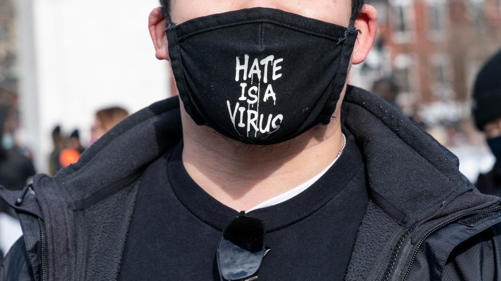 #HateIsAVirus has gone viral in social media posts about the condemning AAPI racism. [Lev Radin/Shutterstock]