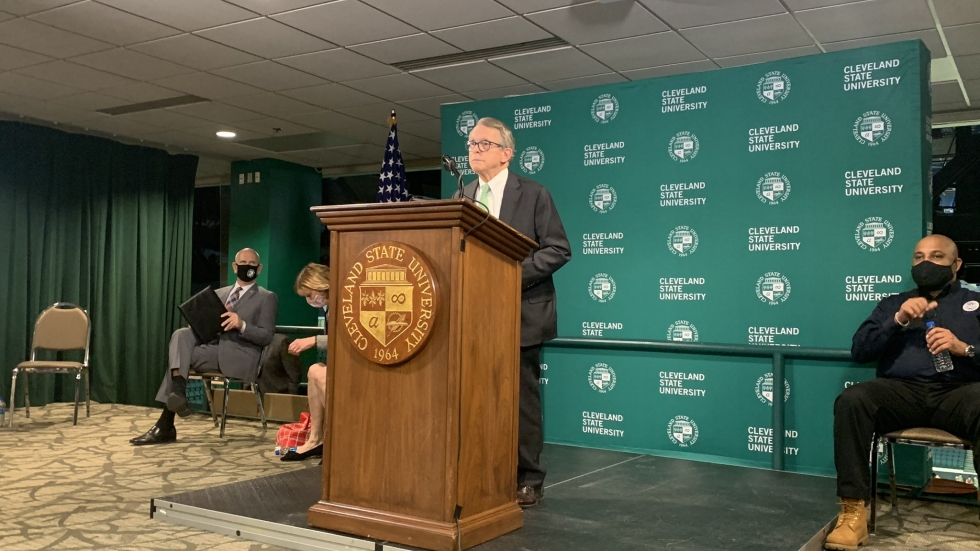 At a press conference at Cleveland State's Wolstein Center March 16, Gov. Mike DeWine announced Ohio will expand COVID vaccine eligibility requirements later this week. By the end of the month, all Ohioans regardless of age will qualify, he said. [Anna Huntsman / ideastream]