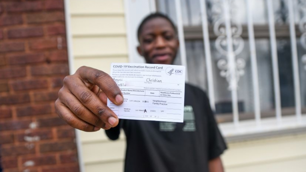 Christian Amuli, a Congolese immigrant and medical assistant at Neighborhood Family Practice said he was wary of the COVID-19 vaccine until he talked one-on-one with a doctor he works with. Now he's vaccinated and is using social media to encourage others to get the shot, too.