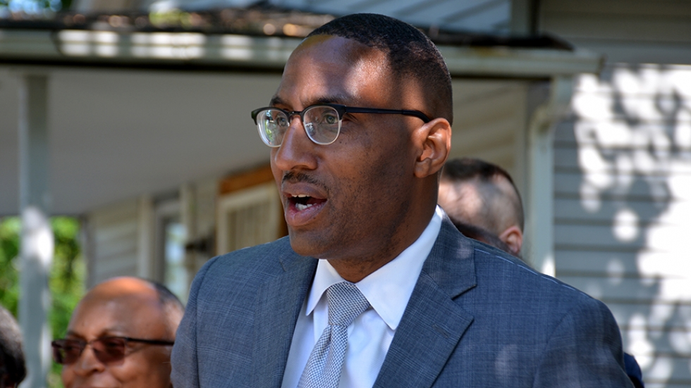 Cleveland City Councilman Zack Reed talks with reporters outside a home in the Union-Miles neighborhood in this 2017 file photo. [Nick Castele / ideastream]