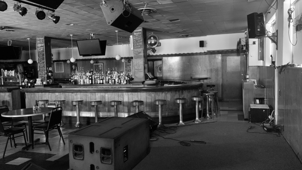 A normally bustling bar and music venue, the Happy Dog in Cleveland's Gordon Square Arts District sits shuttered while the owner seeks federal support..