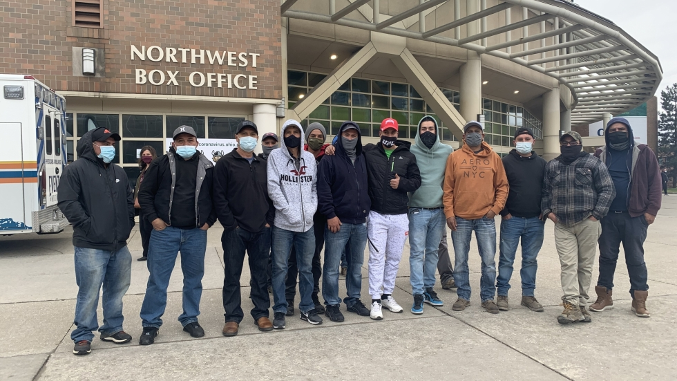 A group of farm workers traveled from Lake County to the Wolstein Center in Cleveland Wed., March 31, 2021 to receive COVID-19 vaccines. [Lisa Ryan / ideastream]