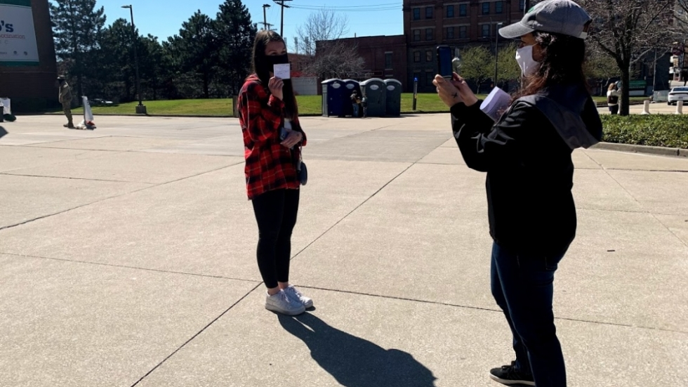 Danielle Rose (right) takes a picture of her 17-year-old daughter, Julia Rose, after Julia received the COVID-19 vaccine at the Wolstein Center in Cleveland March 29, 2021.