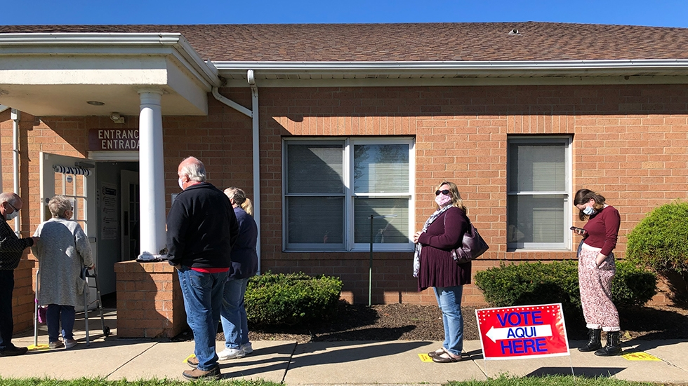 Voters stand in line outside the Lorain County Board of Elections in 2020.