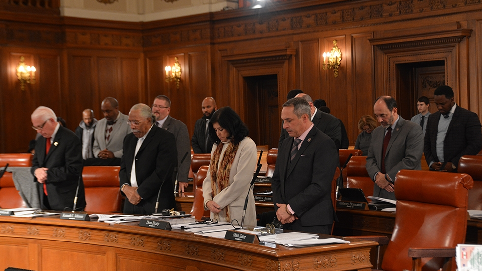 Cleveland City Council members observe a moment of silence at a 2018 meeting.