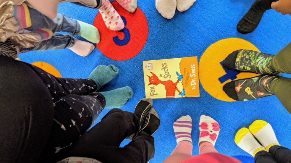 children's feet in a tight circle