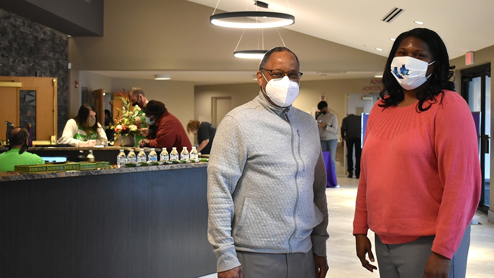 Rev. Ronald Maxwell, pastor of Affinity Missionary Baptist Church, and Keisha Krumm, executive director of Greater Cleveland Congregations, stand in Affinity's lobby during a recent vaccine clinic.