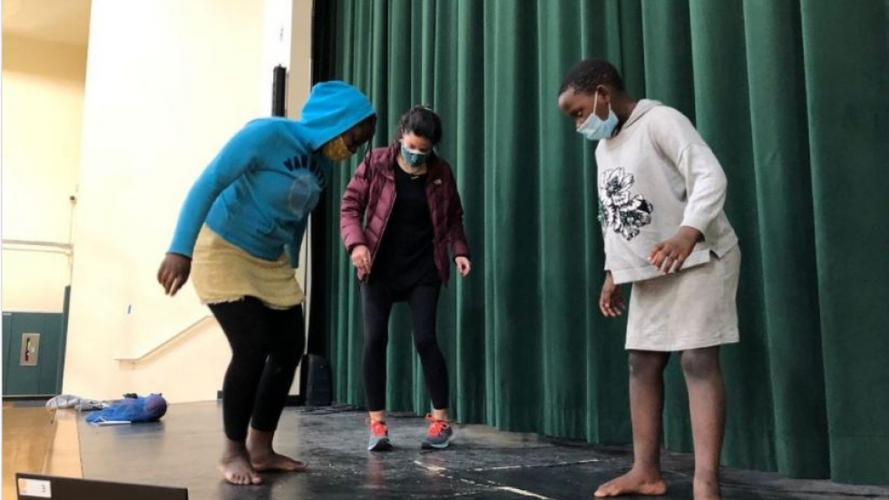 Mentees of The Refugee Response teaching a dance to their mentor at Urban Community School.
