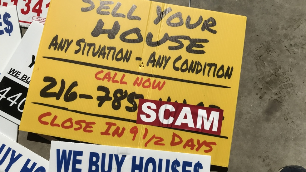 A pile of 'We Buy Houses' signs collected by Brandon Kirsch in Cleveland.