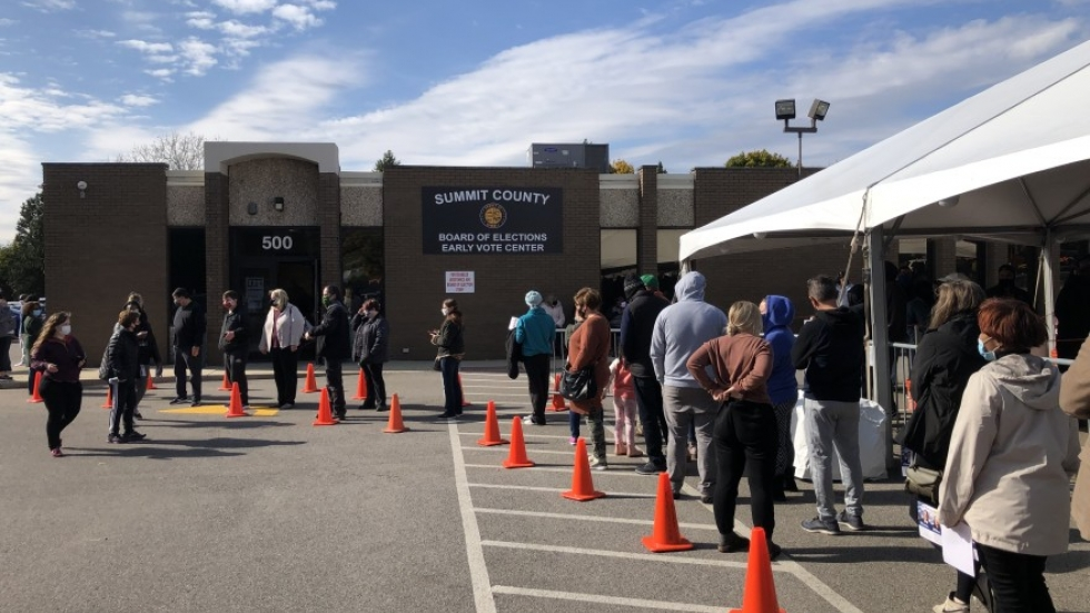 Voters line up to cast ballots outside the Summit County Board of Elections last year