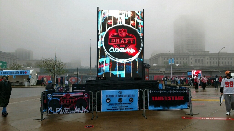 clouds and fog hang over downtown Cleveland and the NFL Draft Experience on Thursday, April 29, 2021