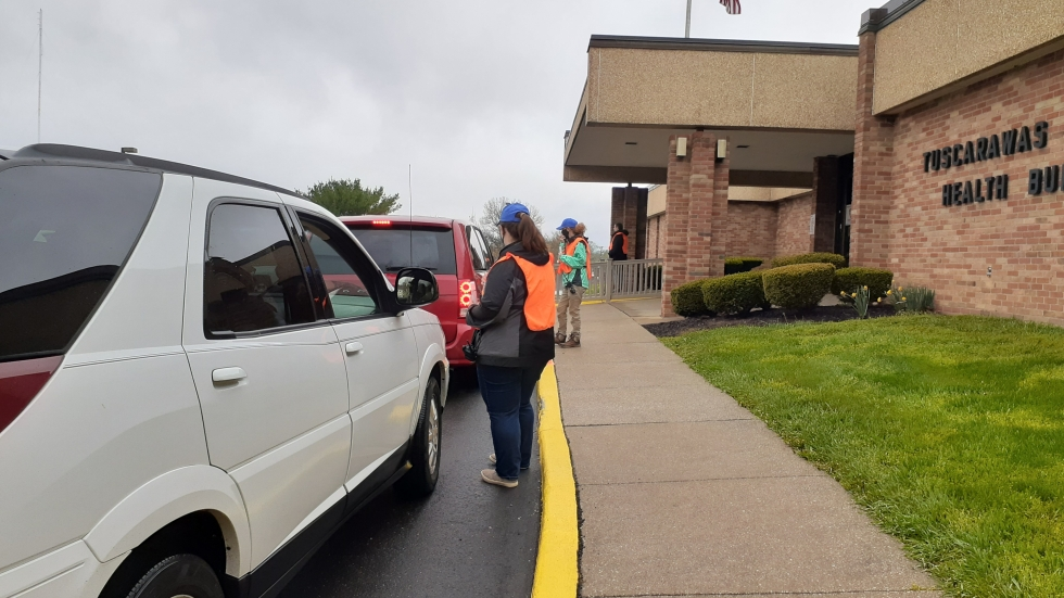 Cars line up for a recent COVID-19 vaccination clinic hosted by the Tuscarawas County health department in Dover, Ohio. Tuscarawas and surrounding rural counties are seeing low vaccine uptake, in part due to misinformation. [Tuscarawas County Health Department]