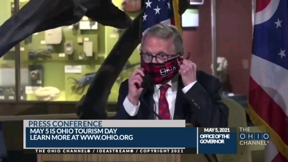 """Ohio Gov. Mike DeWine talked about COVID-19 vaccines for kids and getting back to """"normal"""" on a visit to the Cleveland Museum of Natural History Wednesday, part of his tour promoting Ohio Tourism Day"""