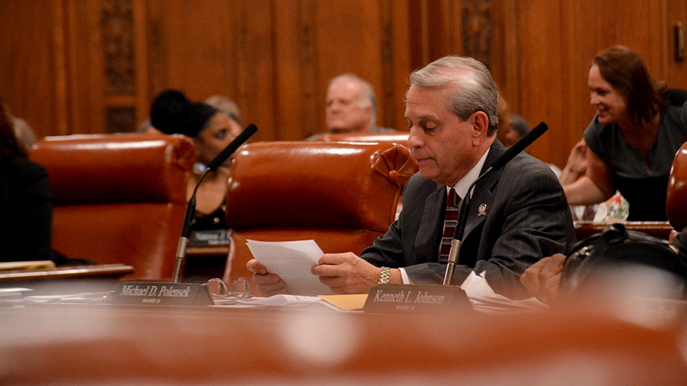 Councilman Mike Polensek reviews papers at his desk during a 2017 Cleveland City Council meeting
