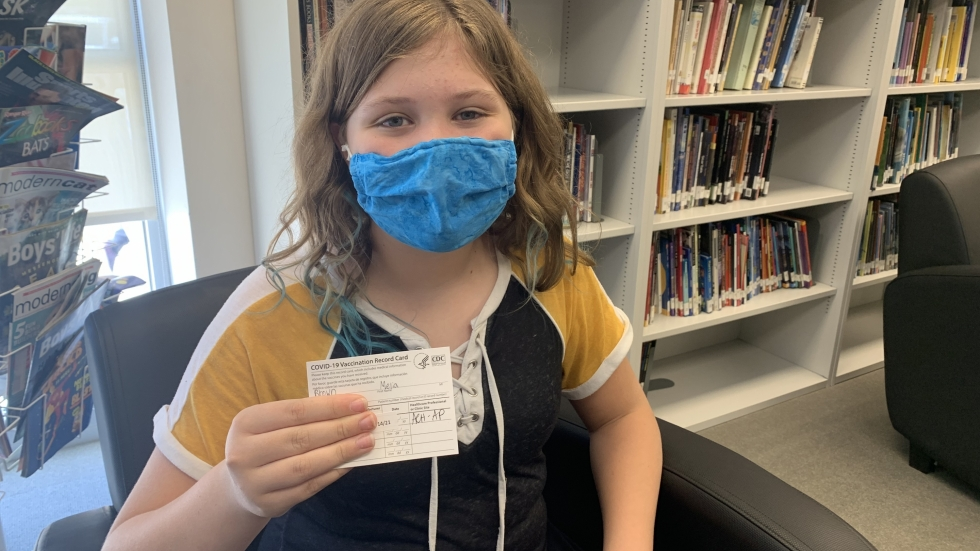 Thirteen-year-old Melia Brown, a seventh grader at Edgewood, got the shot because she wants to keep her dad, who has diabetes, safe. She is also looking forward to birthday parties and sleepovers with her friends. [Anna Huntsman / ideastream]
