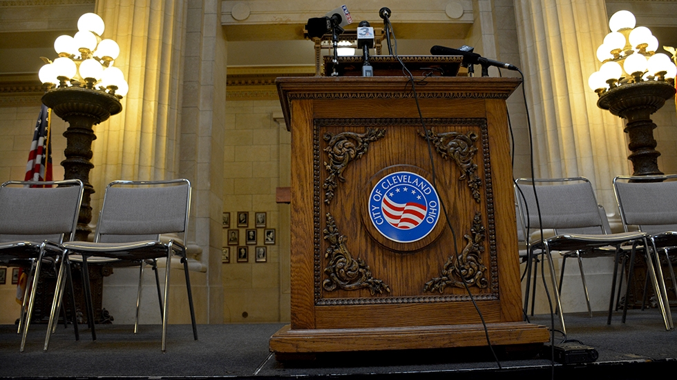A lectern with microphones at Cleveland City Hall
