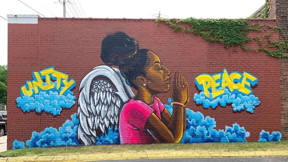 """A photograph shows a mural on Cleveland's East Side by artist Kevin """"Mister Soul"""" Harp."""