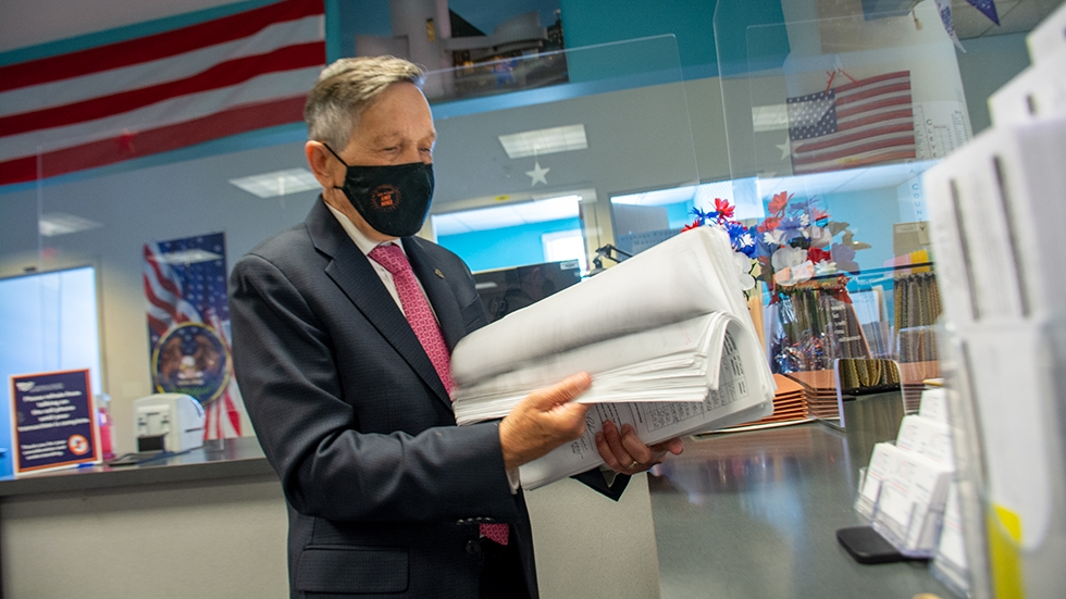 Dennis Kucinich files signatures to make the Cleveland mayoral ballot at the Cuyahoga County Board of Elections on Wednesday.
