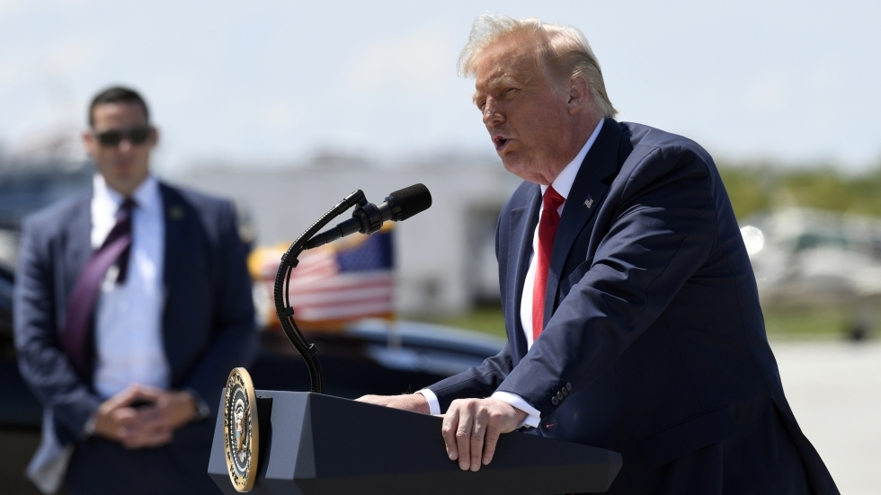 Then-President Donald Trump speaks on the tarmac of Burke Lakefront Airport in Cleveland in August 2020.