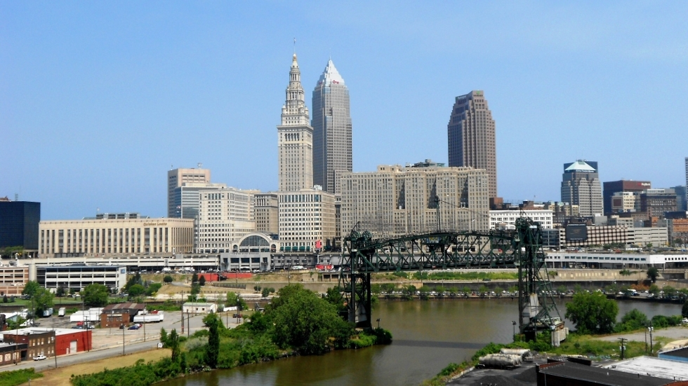 A view of the Cuyahoga River in front of the Cleveland skyline.