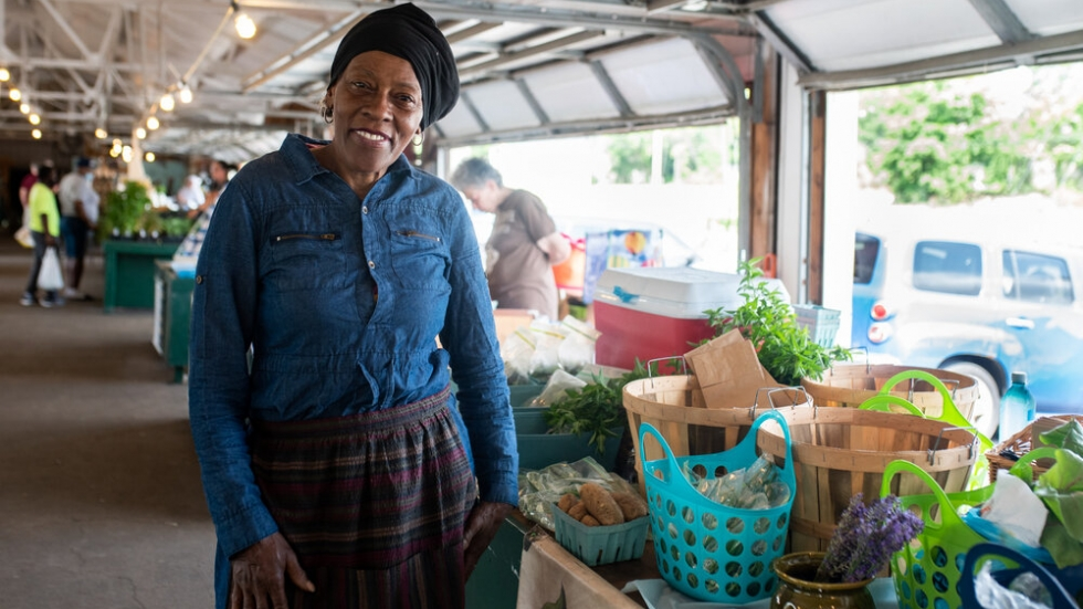Gloria Jalil, a vendor at Coit Road Farmers Market, has been selling produce from her garden since 2008. Many of Jalil's customers use their EBT card to purchase vegetables from her stand. [Kelly Krabill / The Land]