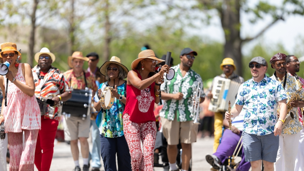 People march in the longtime community arts event Parade the Circle