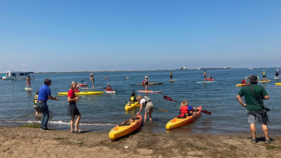 Paddlers and kayakers enter the water of Lake Erie from Wendy Park.