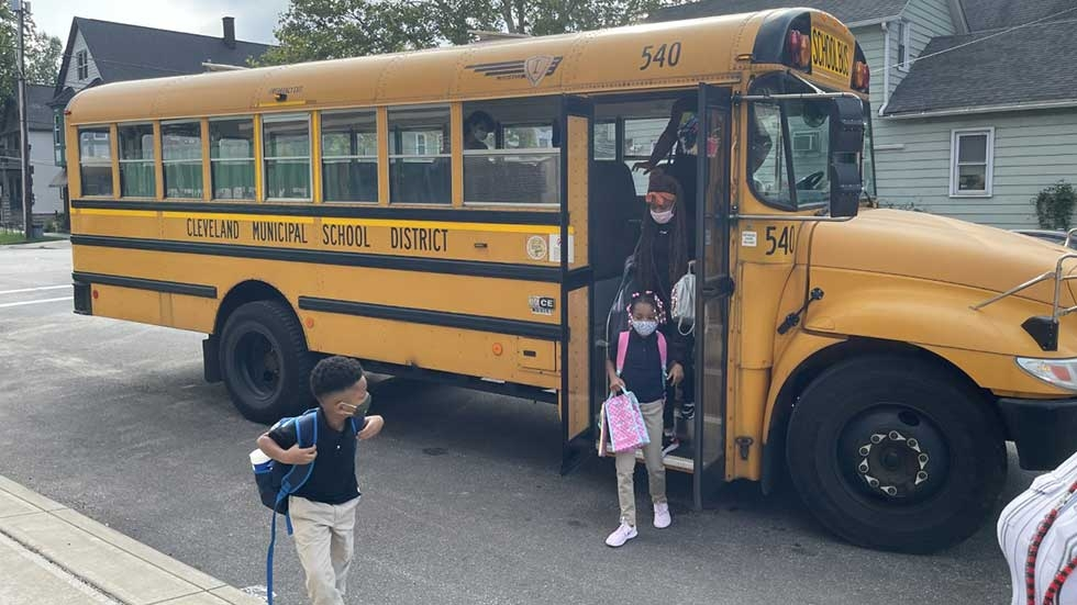 Cleveland Metropolitan School bus and students