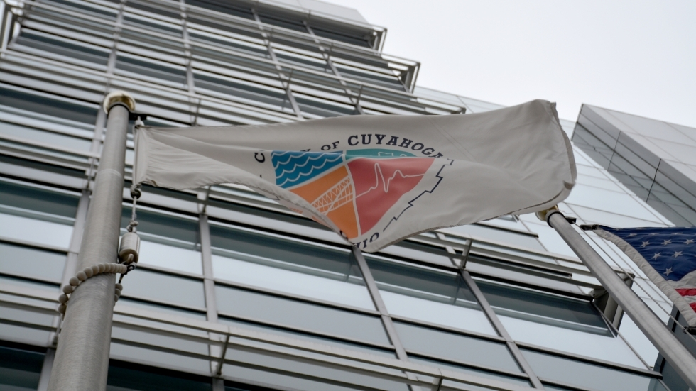 A Cuyahoga County flag waving outside the downtown headquarters.