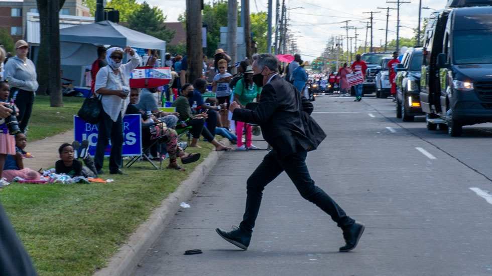 Mayoral candidate and former U.S. Rep. Dennis Kucinich runs toward the reviewing stands at the 11th Congressional District Labor Day Parade in Cleveland.