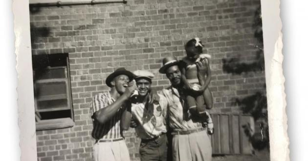 """Family photo of Rochelle Gilbert-Cage taken in 1956. She writes: """"On the left is my father's first cousin William, also known as Snake. My father's brother and cofounder of Gilbert & Gilbert Construction, Hosea Gilbert, is in the middle. On the right is my Uncle J. D. Washington who has me hoisted on his shoulder."""""""