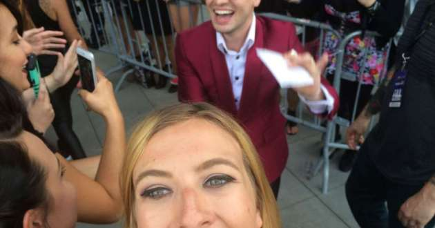 A star-struck fan gets her selfie with Panic at the Disco's Brendon Urie at the 2015 Alternative Press Music Awards