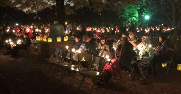 Colleagues and family members honored the memory of slain Shaker Heights teacher Aisha Fraser at a candlelight vigil Monday night.