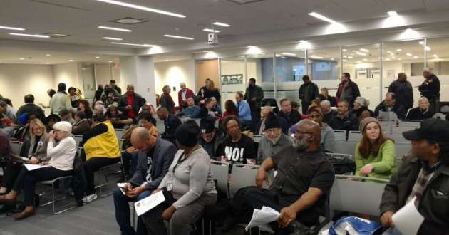 Inside Cuyahoga County Council chambers, protesters demanded improvements at the county jail.