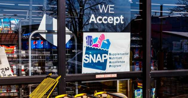SNAP, commonly known as food stamps, sign in a grocery story window