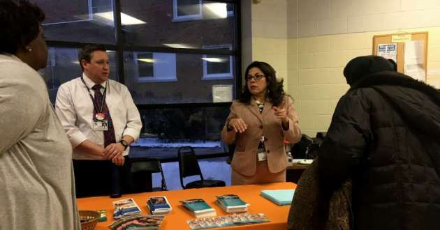 County staff at an information table at a meeting on January 16, 2019.