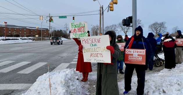 Faculty members picket at the entrance to Wright State University's campus Tuesday, January 22.