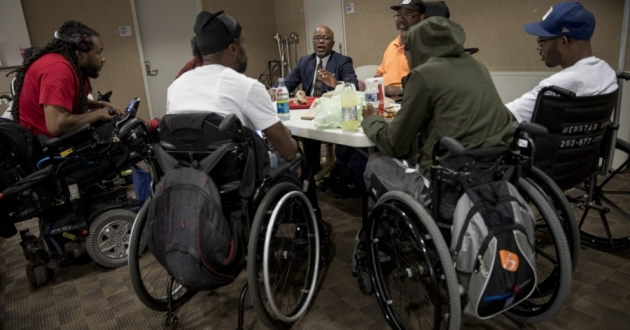 Every Tuesday, a group led by Dr. Samuel Gordon, center, gathers to discuss the daily realities of life in a wheelchair.