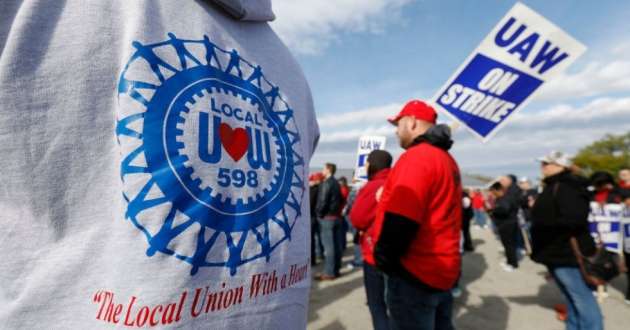 The UAW GM National Council will vote on a new tentative deal Thursday, in a potential end to the national strike that has idled GM plants. Here, union members and their families rallied near the General Motors Flint Assembly plant on Sunday. [Bill Pugliano / Getty Images]