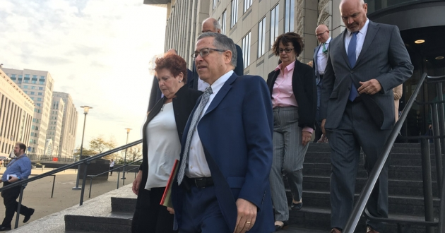 Summit County Executive Ilene Shapiro (left front), Cuyahoga County Executive Armond Budish (right front), Cuyahoga County Prosecutor Michael O'Malley (right back) and other members of the plaintiff's team leave the Carl B. Stokes U.S. Courthouse in Cleveland to announce the settlement Monday. [Nick Castele / ideastream]