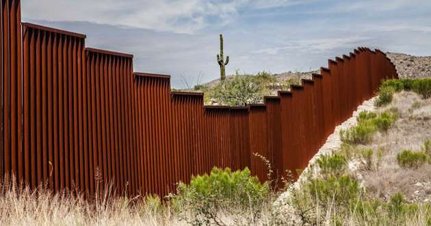An existing walled section of the US-Mexico border in Arizona.