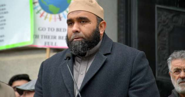 Imam Islam Hassan of the Islamic Center of Greater Cleveland speaks at Friday's vigil.