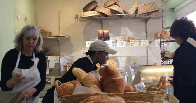 Barbara Zoss (left) helps a customer during a late morning in March. The bakery will close March 30.