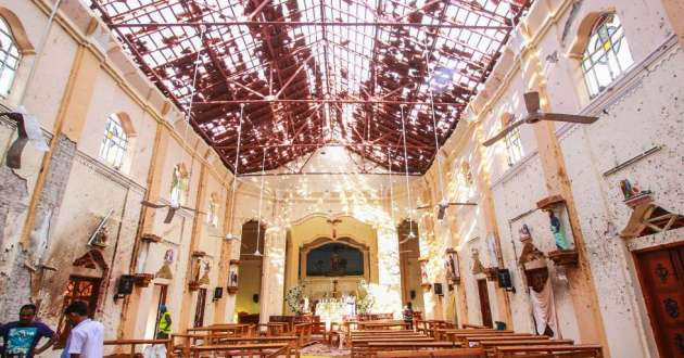 Sri Lankan officials inspect St. Sebastian's Church in Negombo, north of Colombo, Sri Lanka's capital, after a series of explosions on Easter Sunday at churches and hotels across Sri Lanka killed more than 200 people and wounded hundreds more.