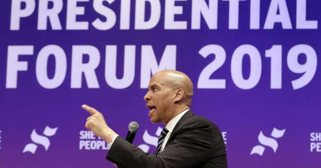 Sen. Cory Booker, D-N.J., answers questions during a presidential forum held by She The People in Houston on Wednesday. [