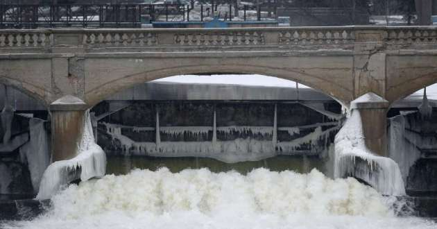 Water from the Flint River flows through the Hamilton Dam. In 2014, the city switched from Detroit's water system to the Flint River, setting the stage for a crisis that sickened residents and cost the mayor and other officials their jobs.