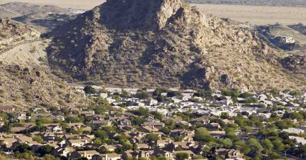 A housing development sits nestled in the South Mountain foothills in the Ahwatukee neighborhood, in Phoenix, Ariz. The city saw the biggest jump in population in the U.S. between 2017 and 2018.