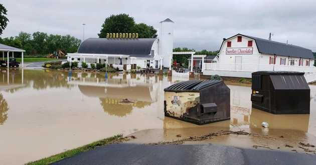 Flooding caused by sustained heavy rains at Grandpa's Cheese Barn and Sweetie's Chocolates in Ashland, OH,