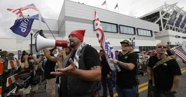 A group from the Proud Boys confronts anti-Trump protesters outside Trump's 2020 campaign kickoff rally Tuesday in Orlando, Fla. The Proud Boys group is known for white nationalist and other extremist rhetoric.