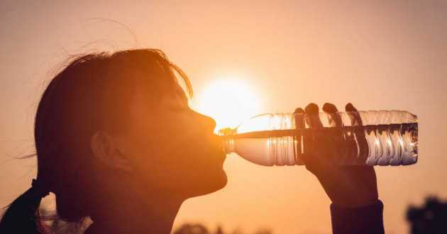 Staying hydrated is an important part of keeping cool and healthy during a summer heat wave. [FocusStock / Shutterstock]